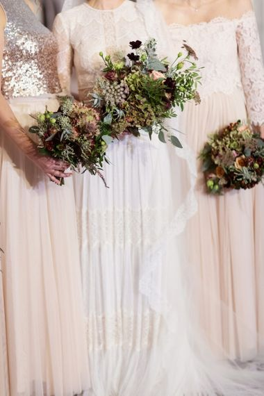 Bridal Party Winter Wedding Bouquets with Deep Red and Green Flowers and Foliage