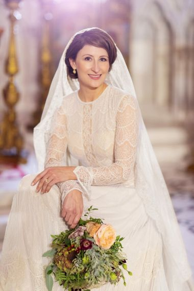 Beautiful Bride in Delicate Lace Lihi Hod Sophia Wedding Dress with Long Sleeves and High Neck