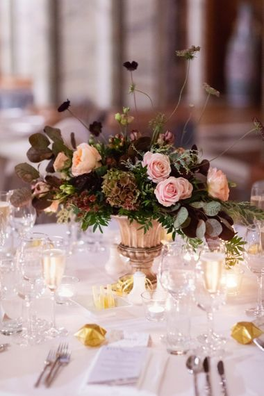 Pink and Deep Red Winter Wedding Flower Centrepiece in Gold Vessel