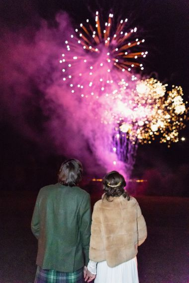 Bride and Groom Enjoying Fireworks Display