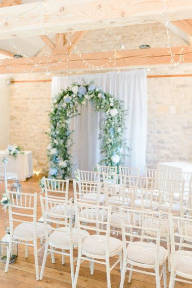 Ceremony Room at at The Priory Barns and Cottages with Blue and White Floral Arch Altar
