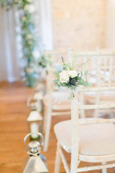 Aisle Chairs with White and Blue Wedding Flowers