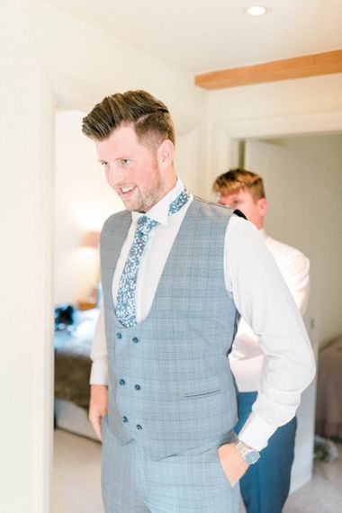 Groom in Blue Check Suit and Horseshoe Waistcoat