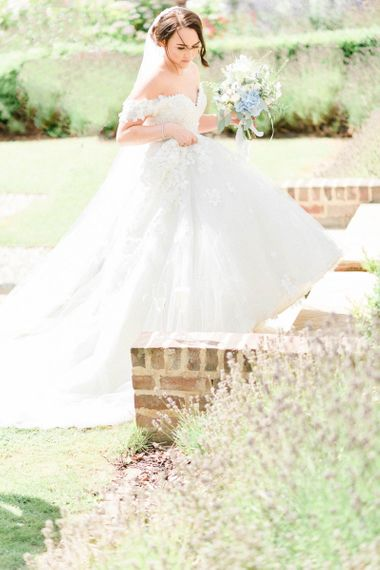 Bride in Appliqué Ian Stuart Wedding Dress with Bardot Neckline