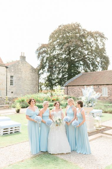 Bridal Party Portrait with Bride in Appliqué Ian Stuart Wedding Dress and Bridesmaids in Blue Multiway Dresses