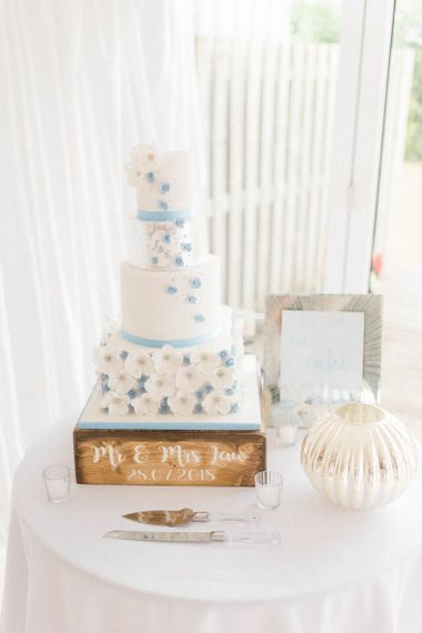 Blue and White Wedding Cake with Hydrangea Petal Design