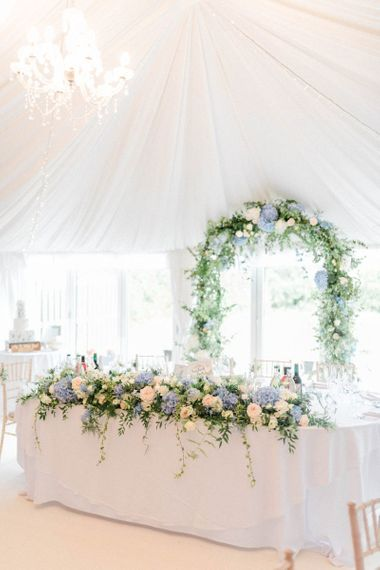 Top Table Wedding Flowers with Blue, White and Foliage Arrangement and Floral Arch