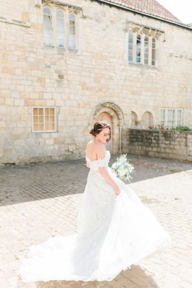 Bride in a Bardot Ian Stuart Wedding Dress with Appliqué Detail