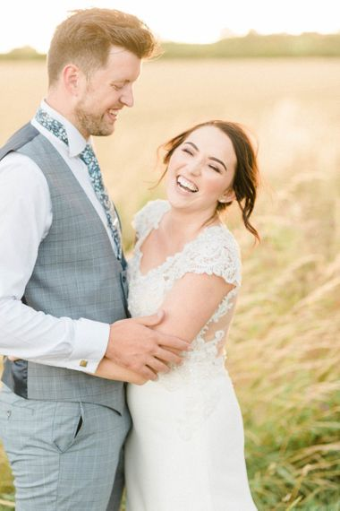 Bride and Groom Laughing in the Fields