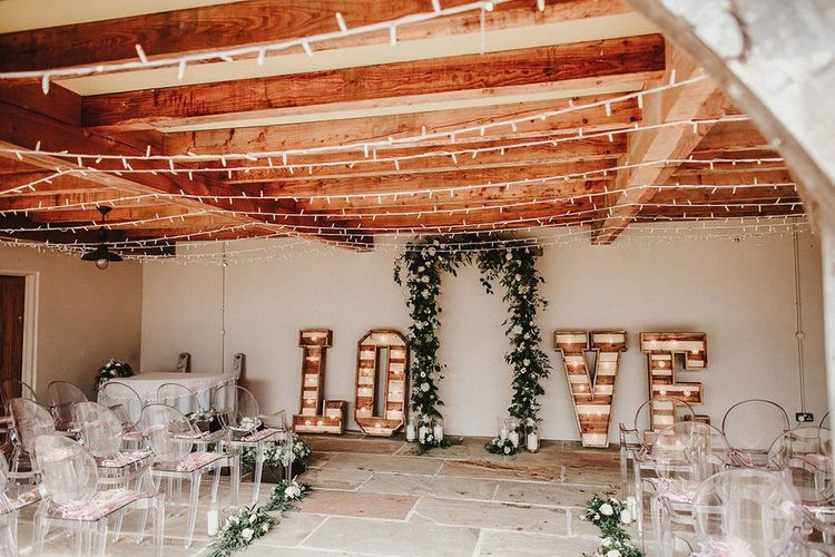Aisle Style | Floral Arch | Giant Light Up LOVE Letters | Blush, Rustic Luxe Wedding at Ever After, Dartmoor | Dan Ward Photography | CupcakeVideos