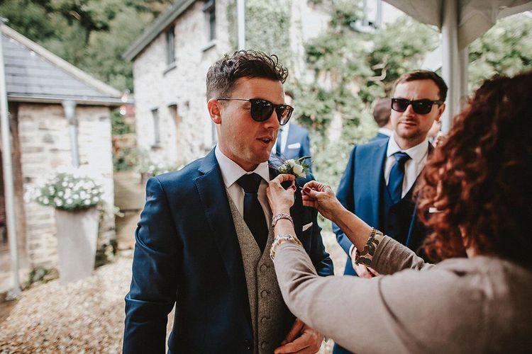 Groom in Navy Remus Uomo Suit & Grey Waistcoat | Blush, Rustic Luxe Wedding at Ever After, Dartmoor | Dan Ward Photography | CupcakeVideos