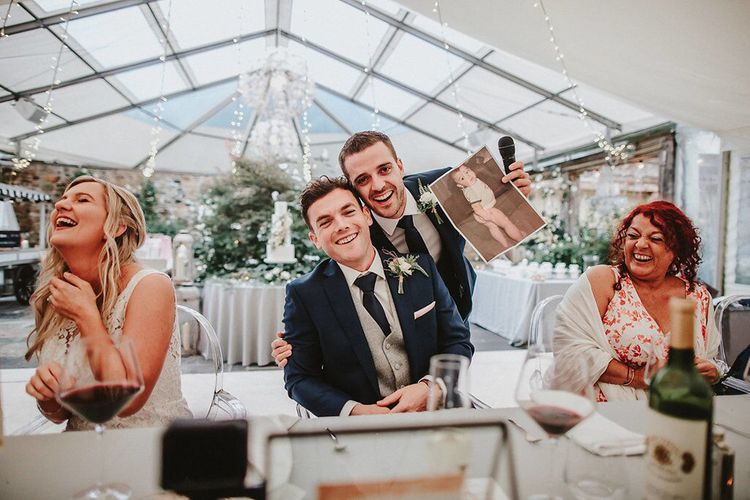 Reception Speeches | Groom in Navy Remus Uomo Suit & Grey Waistcoat | Blush, Rustic Luxe Wedding at Ever After, Dartmoor | Dan Ward Photography | CupcakeVideos
