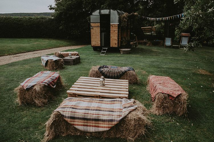 DIY Hay Bale Seating Area & Horse Box Bar | English Country Garden Marquee Wedding at the Family Home on the Isle of Wight | Jason Mark Harris Photography