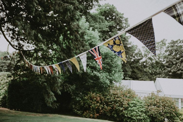 DIY Bunting Wedding Decor | English Country Garden Marquee Wedding at the Family Home on the Isle of Wight | Jason Mark Harris Photography