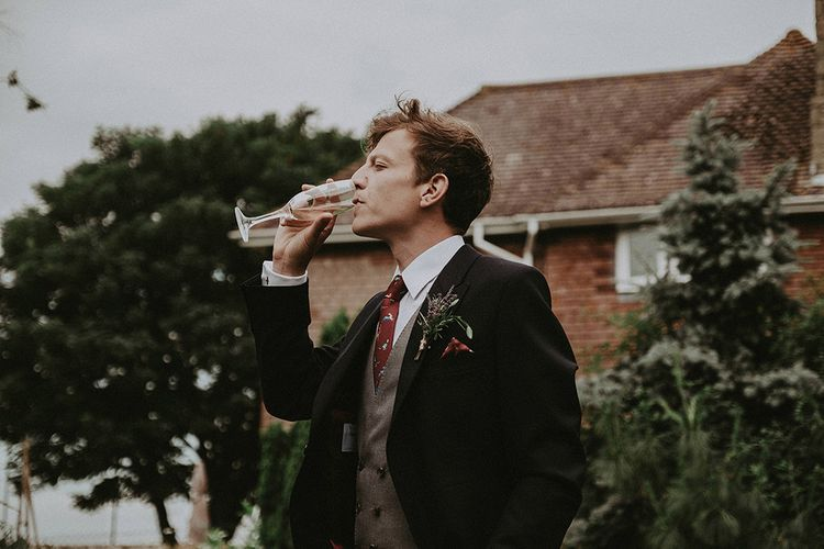 Groom in Henry Herbert Tailors Suit | English Country Garden Marquee Wedding at the Family Home on the Isle of Wight | Jason Mark Harris Photography