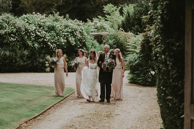 Bridal Entrance in LaceRime Arodaky Gown | Bridesmaids in Pink Monsoon Dresses | English Country Garden Marquee Wedding at the Family Home on the Isle of Wight | Jason Mark Harris Photography