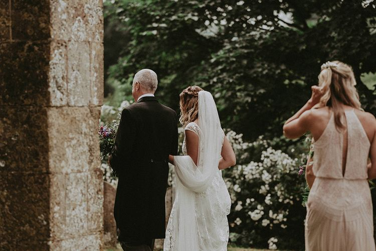 Bridal Entrance in LaceRime Arodaky Gown | English Country Garden Marquee Wedding at the Family Home on the Isle of Wight | Jason Mark Harris Photography