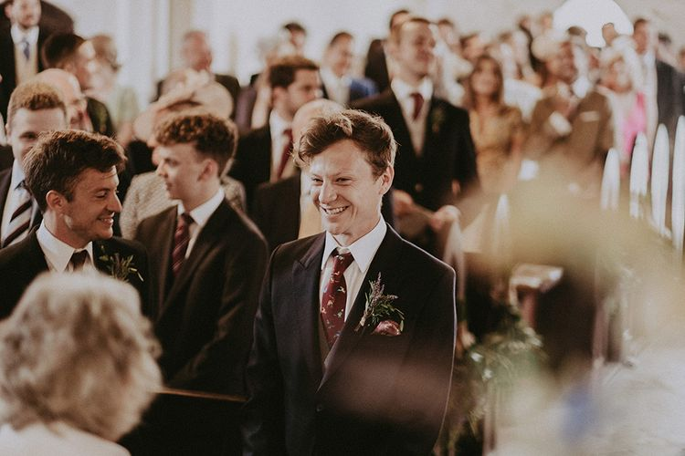 Groom at the Altar  in Henry Herbert Tailors Suit | English Country Garden Marquee Wedding at the Family Home on the Isle of Wight | Jason Mark Harris Photography