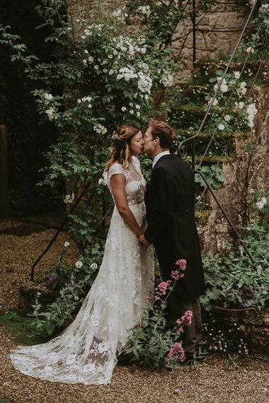 Bride in Lace Rime Arodaky Wedding Dress | Groom in Henry Herbert Tailors Suit | English Country Garden Marquee Wedding at the Family Home on the Isle of Wight | Jason Mark Harris Photography