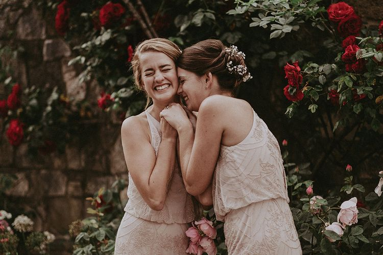Bridesmaid in Different Pink Monsoon Dresses | English Country Garden Marquee Wedding at the Family Home on the Isle of Wight | Jason Mark Harris Photography