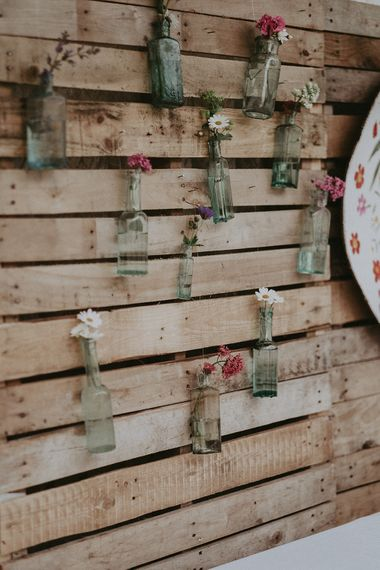 DIY Wooden Palette & Bottle Wedding Decor | English Country Garden Marquee Wedding at the Family Home on the Isle of Wight | Jason Mark Harris Photography
