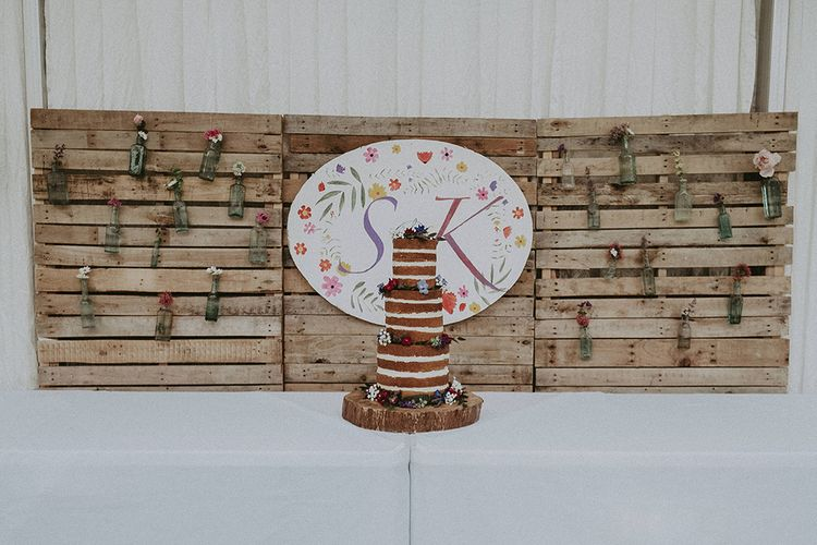 Cake Table with Rustic DIY Backdrop Wedding Decor | English Country Garden Marquee Wedding at the Family Home on the Isle of Wight | Jason Mark Harris Photography