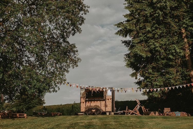Horse Box Bar | Bunting Wedding Decor | English Country Garden Marquee Wedding at the Family Home on the Isle of Wight | Jason Mark Harris Photography