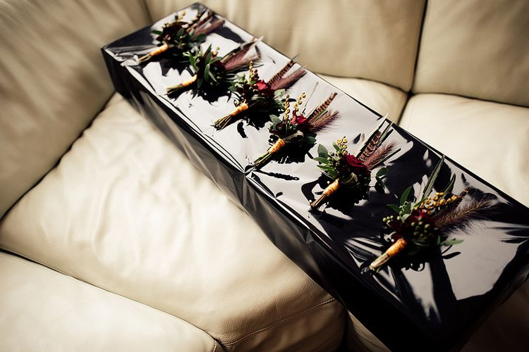 Box of Groomsmen Buttonholes with Foliage, Red Rose and Pheasant Feather