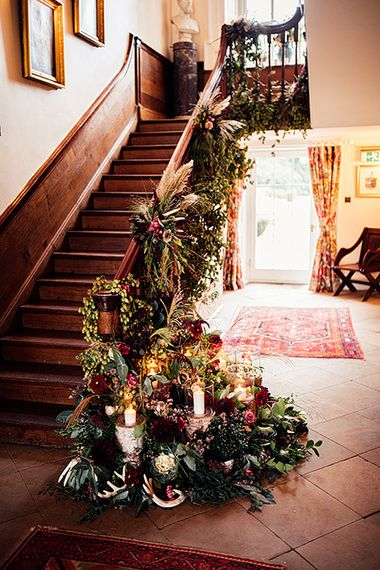Staircase Wedding Floral Arrangement with Foliage, Red Flowers, Pampas Grass and Pheasant Feathers