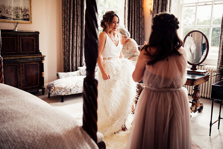 Wedding Morning Bridal Preparations with Bride in Charlie Brear Payton Bridal Gown & Piora Feather Skirt