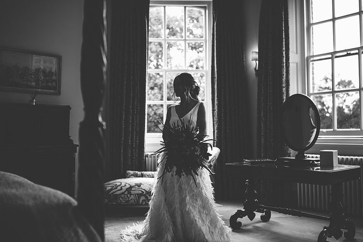 Black & White Portrait of Bride on Wedding Morning in her Charlie Brear Payton Bridal Gown & Piora Feather Skirt