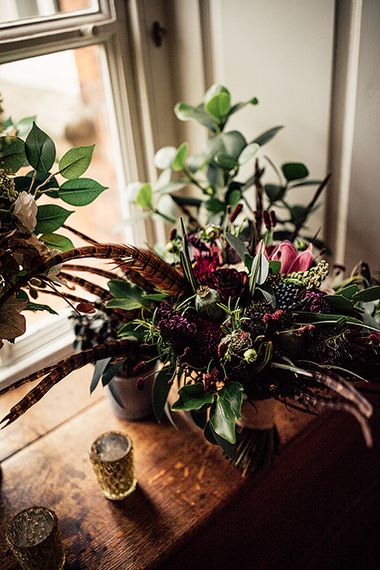 Foliage,  Red Flowers and Pheasant Feather Floral Arrangement