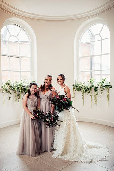 Bridal Party Portrait with Bride in Charlie Brear Payton Bridal Gown & Piora Feather Skirt and Bridesmaids in Dusky Pink Tulle Dresses