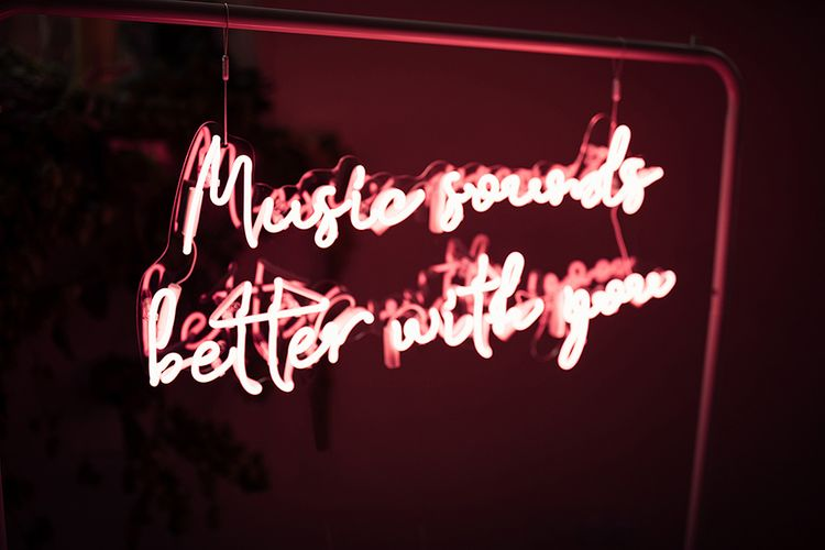 Pink Neon 'Music Sounds Better With You' Sign