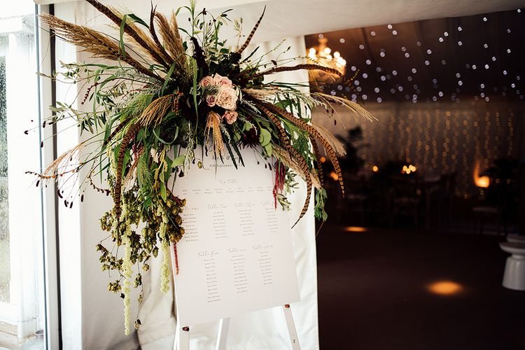 Table Plan with Floral Arrangement including Pampas Grass, Pheasant Feathers, Foliage and Red Flowers