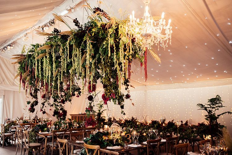 Hanging Floral Installation including Pampas Grass, Pheasant Feathers, Foliage and Red Flowers