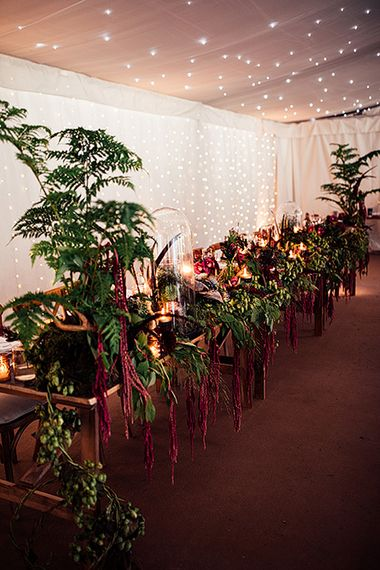 Top Table Wedding Floral Arrangement including Foliage, Red Flowers  and Candle Light