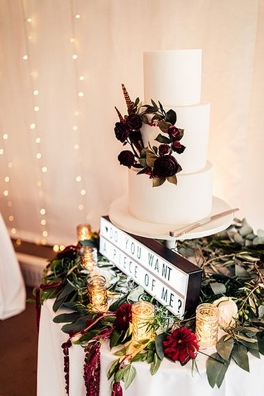 Elegant Wedding Cake with Floral Skirt and 'Do You Want a Piece of Me' Light Box Sign