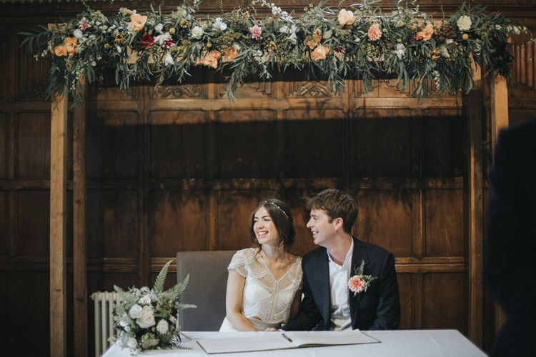 Wedding Ceremony | Bride in Suzanne Neville Separates | Groom in Gieves and Hawkes Suit | Intimate Wedding at The Olde Bell Pub, Berkshire | Revival Rooms Floral Design, Decor & Styling | Grace Elizabeth Photo & Film