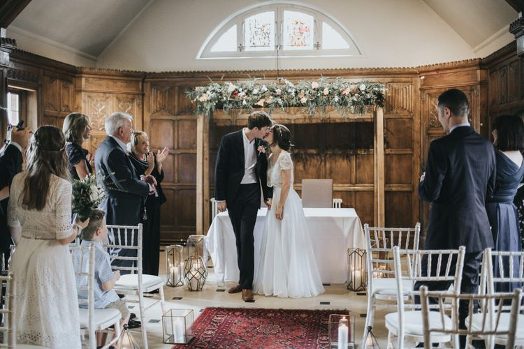 Wedding Ceremony | Floral Garland | Bride in Suzanne Neville Separates | Groom in Gieves and Hawkes Suit | Intimate Wedding at The Olde Bell Pub, Berkshire | Revival Rooms Floral Design, Decor & Styling | Grace Elizabeth Photo & Film