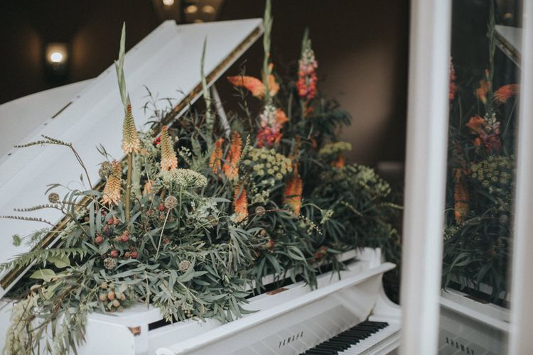 Floral Covered Piano | Intimate Wedding at The Olde Bell Pub, Berkshire | Revival Rooms Floral Design, Decor & Styling | Grace Elizabeth Photo & Film