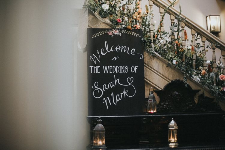 Chalkboard Welcome Wedding Sign | Floral Staircase Decor | Intimate Wedding at The Olde Bell Pub, Berkshire | Revival Rooms Floral Design, Decor & Styling | Grace Elizabeth Photo & Film