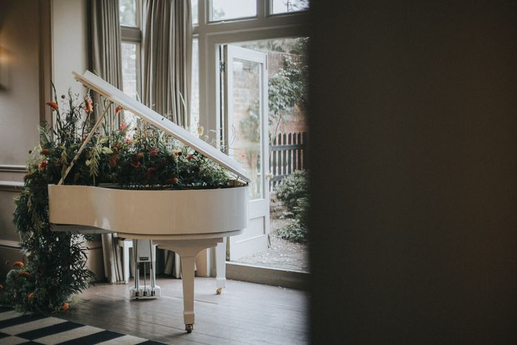 Flower Cover Grand Piano | Intimate Wedding at The Olde Bell Pub, Berkshire | Revival Rooms Floral Design, Decor & Styling | Grace Elizabeth Photo & Film