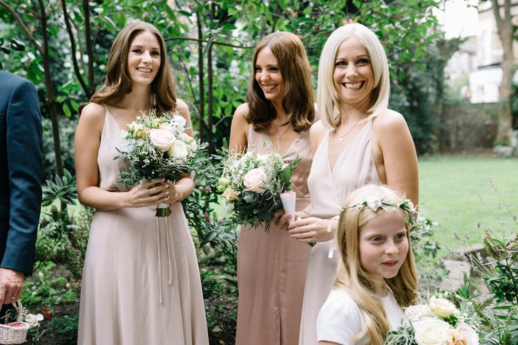 Bridesmaids In Reformation // Waterside Wedding Venue London Winchester House Bride In Rime Arodaky & Groom In Reiss Images From Photography By Krishanthi