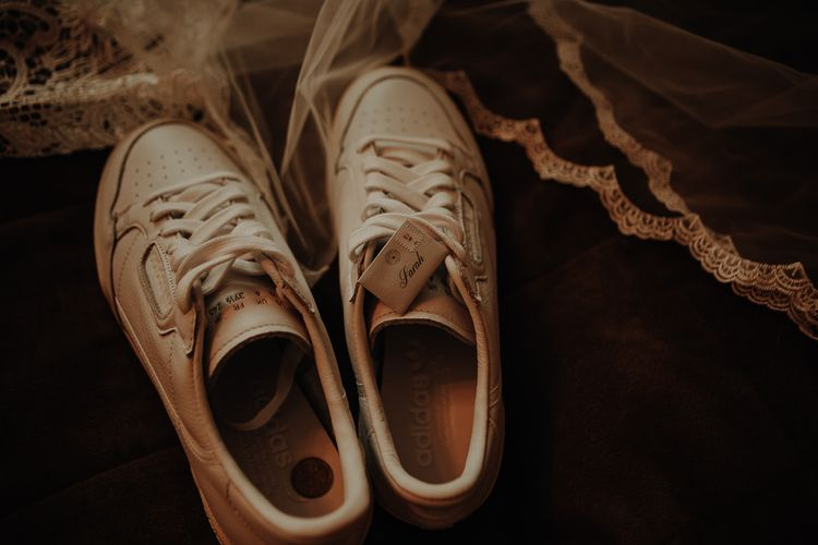 White trainers for bridal shoes at relaxed autumn wedding with DIY touches