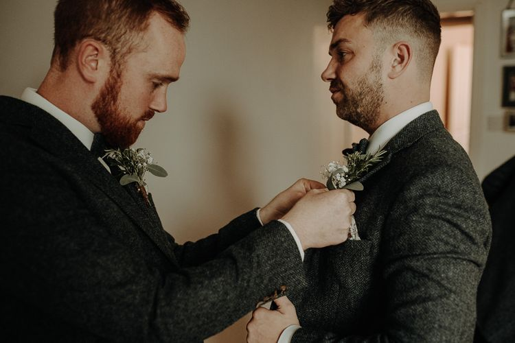 Groom wearing floral buttonhole for relaxed wedding at Victoria Baths