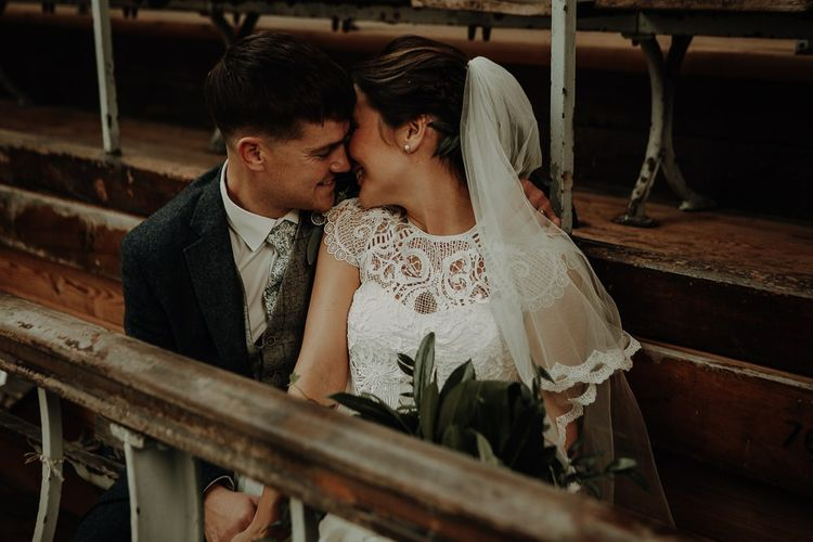 Bride and groom steal a moment at Victoria Baths wedding wearing lace bridal top and veil