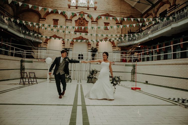 Bride and groom at Victoria Baths in Manchester for botanical styled reception with DIY decor