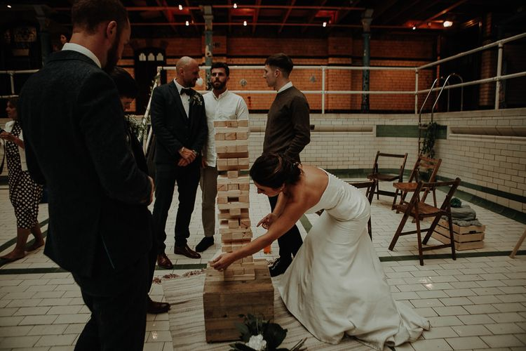 Party games at relaxed wedding reception in Manchester
