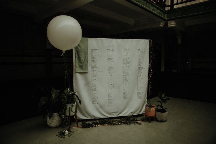 DIY table plan with balloon decor at botanical styled reception in autumn
